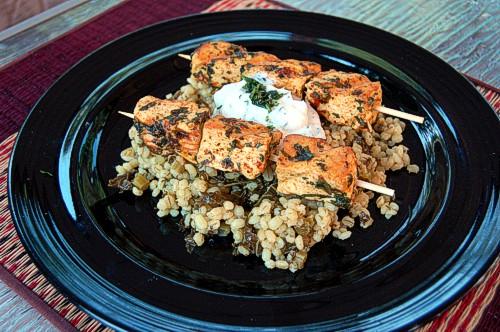 Tandoori Marinated Tofu using Arvinda's Tandoori Masala on skewers on a bed of curried barley.